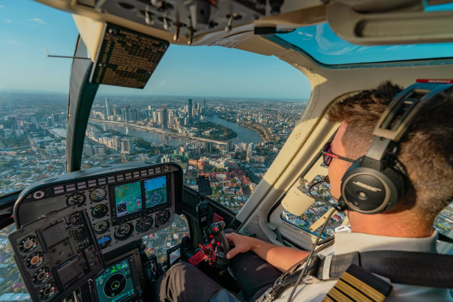 Brisbane City through cockpit of Bell Longrager Helicopter